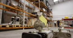 Two managers looking at stock in a large warehouse Stock Footage