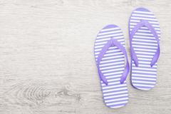 Flip flop on wooden background Stock Photos