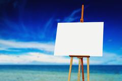 Easel with Blank Canvas on the Beach - stock illustration