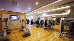 Gym hall with many fitness equipment in modern hotel Stock Footage