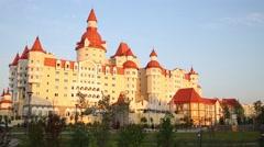 Hotel Bogatyr at summer evening In Sochi, Russia. Stock Footage