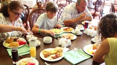 Grandma, grandpa, mother and son eat in dinning room of hotel Stock Footage