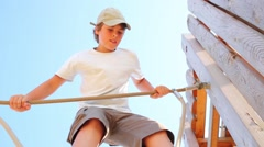 Boy climbs on rope way in playground at sunny day, bottom view Stock Footage