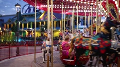 Children ride on horses of carousel In Sochi, Russia. Stock Footage