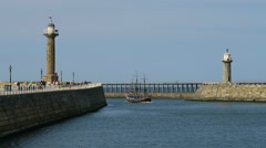 Pirate boat enter Whitby harbor - stock footage