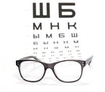 Glasses and test chart for the eye Stock Photos