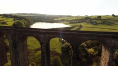 Descending aerial view of Hewenden Viaduct, Cullingworth, Bradford, Yorkshire Stock Footage