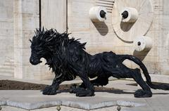 Lion art satue made from car tyres at Yerevan Cascade stairway , Armenia - stock photo