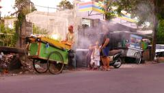 Sweet corn roasting on street, food vendor cart, alot of smoke from brazier Stock Footage