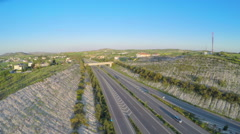 Cars driving on modern highway. Aerial shot of traffic. Video filmed with drone Arkistovideo