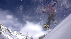 Mountaineer leaps off snow covered mountains. Stock Footage