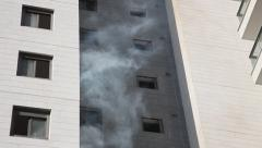 An apartment is burning in a high rise building under construction - stock footage