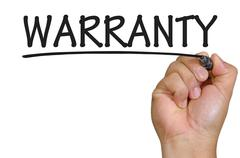 hand writing warranty - stock photo