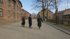 Stock Video Footage of Jews with black robes at Auschwitz