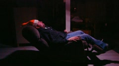 A Father sits on a couch Stock Footage