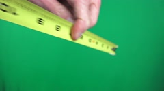 Hand extending tape measure Stock Footage