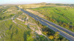 Fantastic aerial shot of beautiful landscape, green hills, busy traffic on road Arkistovideo