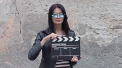 Fashionable girl with clapboard Stock Footage
