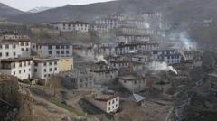Kibber village early in the morning with smoke,Kibber,Spiti,India Stock Footage