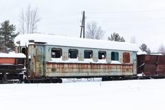 Abandoned  rusty  wagons on narrow-gauge railway - stock photo
