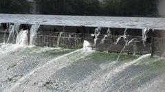 Water Spilling over Dam Stock Footage
