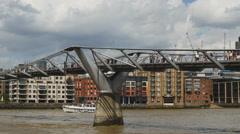 River craft under London Millennium footbridge 4K Stock Footage