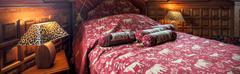 Stock Photo of Comfortable bed in baroque bedroom