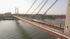 Train crosses the railroad bridge over the river Stock Footage