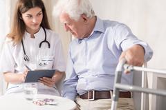 Practitioner prescribing medicament - stock photo