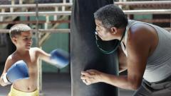 Child and hispanic trainer practicing in boxing gym sport fun Stock Footage