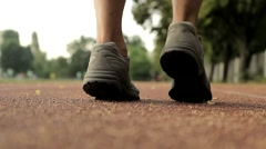 Stock Video Footage of Running Feet on a Running Track Sport and Health Concept