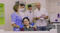 Professor conducts classes for interns in the dental clinic Stock Footage