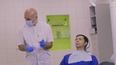 Anesthesiologist makes an injection to a patient Stock Footage