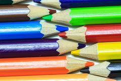 Colour pencils on white - stock photo