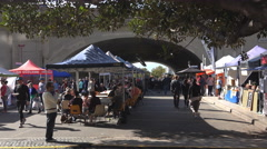 Outdoor market held under overbridge - stock footage