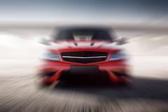 red sport car speed fast drive. blur background - stock photo