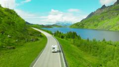 Beautiful aerial drone shot of a camper at lake in the mountain Stock Footage