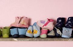 Baby shoes on a shelves Stock Photos