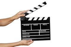 young man with a traditional wooden clapperboard - stock photo