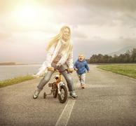 Stock Photo of Happiness Mother and son on the bicycle outdoor