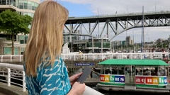 Sea boat arrives to quay,  beautiful female smiling Stock Footage