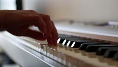 Young woman playing  piano, closeup Stock Footage