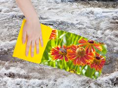 Hand deletes melting snow by yellow cloth Stock Photos