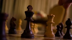 Queen takes king chess Stock Footage