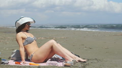 Pretty woman on beach, upset with bad weather, stormy sea. Ruined vacation Stock Footage