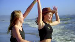 Girls hug and dance - stock footage