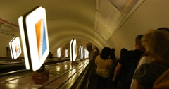 Going down to the platform. A Crowd of People Are Going Down The Undeground on Stock Footage