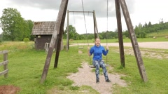 Teen girl on a seesaw Stock Footage