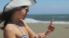 Happy beautiful female making selfie on smartphone at seaside, social networks Stock Footage