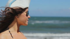 Closeup of young female in sunglasses enjoying relax on sunny beach at seaside Stock Footage